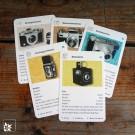 Das Foto- / Kameraquartett zeigt 32 unterschiedliche Motive aus der Zeit der Silberfotografie.
