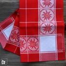 Schweizer Baumwoll Geschirrhandtuch in Rot/Weiß mit Edelweiß in der Bordüre.