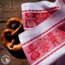 """Geschirrtuch """"Tiroler Paar"""" mit beidseitig gewebter Bordüre in Rot-Weiß und traditionellem Webmuster. (Lieferung OHNE Dekoration)"""
