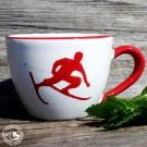 Teetasse Maxima mit Toni dem Skifahrer. Original handbemalte Gmundner Keramik.